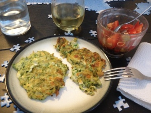 zucchini pancakes, tomato salad and wine, on top of my 1/2 completed jigsaw puzzle